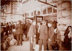 Races, Immigration: United States. New York. New York City. Immigrant Station: Regulation of Immigration at the Port of Entry. United States Immigrant Station, New York City: Under canopy, waiting to enter main entrance to hall..   Social Museum Collection