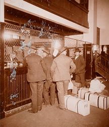 Races, Immigration: United States. New York. New York City. Immigrant Station: Regulation of Immigration at the Port of Entry. United States Immigrant Station, New York City: Aliens waiting for tickets at railway ticket office..   Social Museum Collection