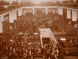Races, Immigration: United States. New York. New York City. Immigrant Station: Regulation of Immigration at the Port of Entry. United States Immigrant Station, New York City: View of main floor. Immigrants awaiting further inspection..   Social Museum Collection
