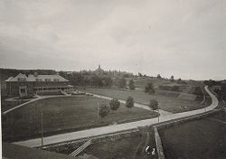 Defectives, Insane: United States. Massachusetts. Worcester. Insane Asylum: Worcester Lunatic Hospital: Farm house; hospital in background.   Social Museum Collection