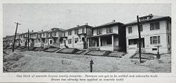 Housing, Industrial: United States. Pennsylvania. Donora: Industrial Housing. Detached and Semi-Detached Houses of Poured Concrete: Built for the American Steel & Wire Co., at Donora, Pa.: Designs by Lambie Concrete House Corporation, New York City. Construction by Lambie Concrete House Corporation and Aberthaw Construction Co., Boston: One block of concrete houses nearly complete. Terraces are yet to be sodded and sidewalks built. Stucco has already been applied on concrete walls..   Social Museum Collection