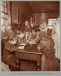 Races, Immigration: United States. New York. New York City. Immigrant Station: Regulation of Immigration at the Port of Entry. United States Immigrant Station, New York City: Women's Detained Room: Writing the First Letter Home..   Social Museum Collection