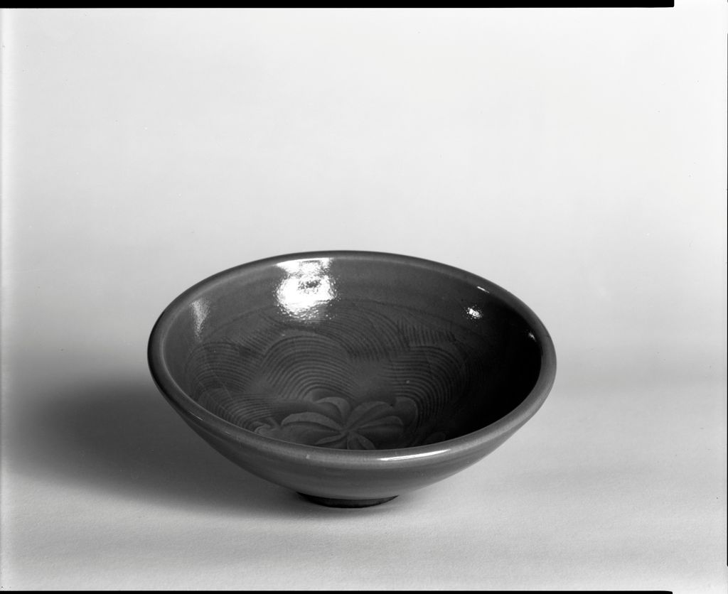 Small Circular Bowl With Stylized Lotus And Wave Decor