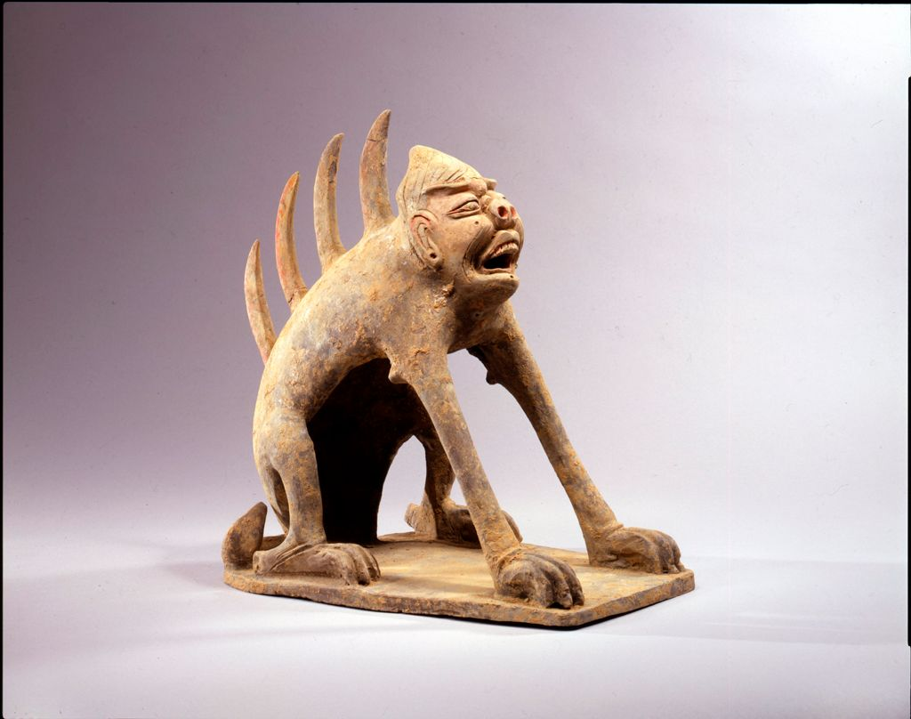 Guardian Creature With Human Face, From The Tomb Sculpture Set: Pair Of Guardian Creatures With Spiked Spines, One With A Human Face, One With A Feline Face