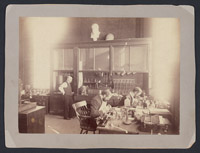 [Unidentified man, William F. Whitney (center), and Franklin Dexter (right) in anatomy laboratory], Digital Object