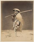 Work 31 of 48 Title: Man wearing straw raincoat (mino) and ba... Creator: Stillfried, Baron Raimund von Date: 187-?