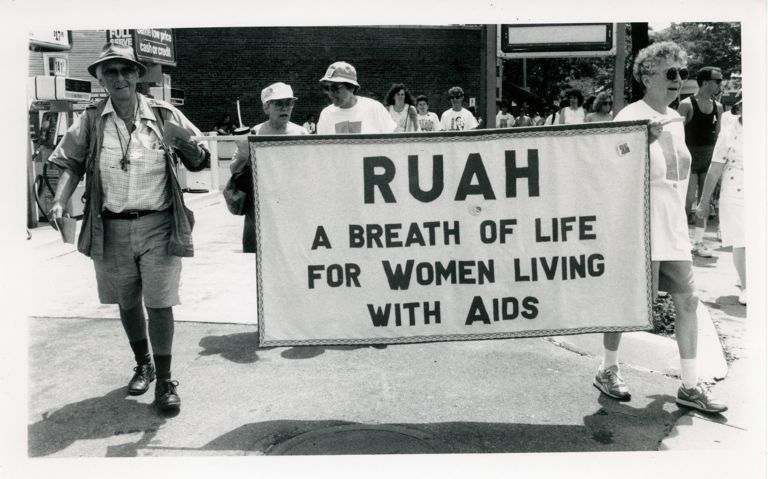 "Kip Tiernan and Sr. Jeanette marching with Ruah (interfaith organization) banner. Text reads ""A breath of life for women living with AIDS"""