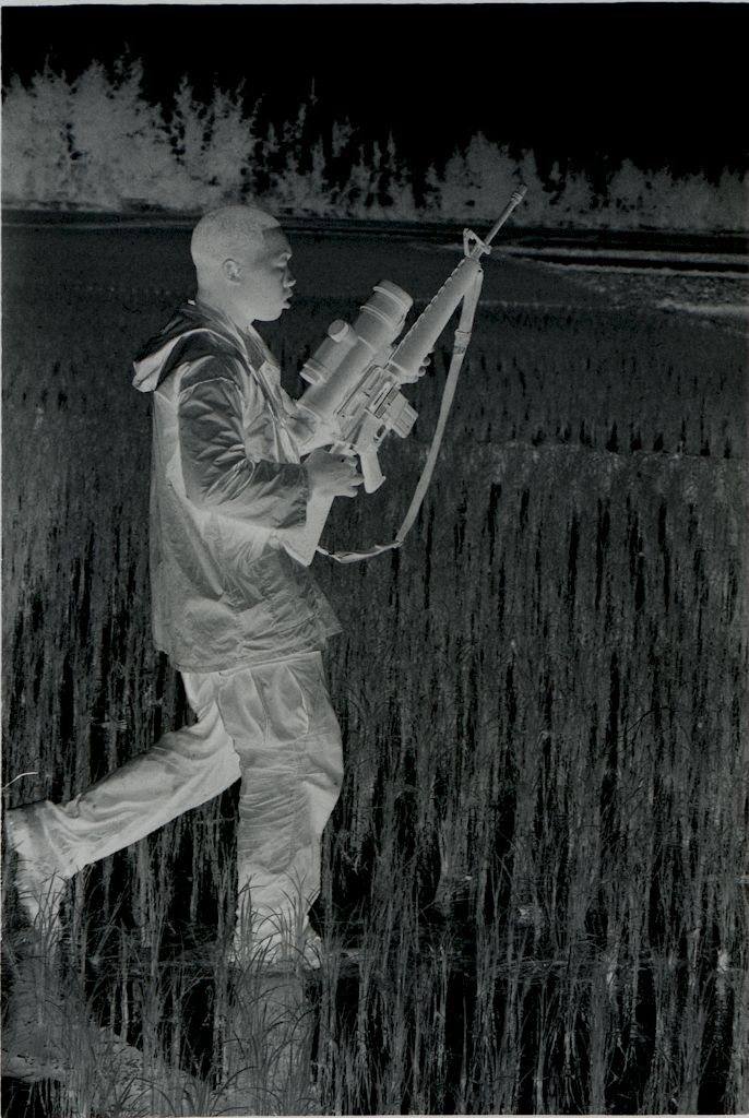 Untitled (Soldier Walking Through Rice Paddy Carrying Rifle With Sight Attachment, Vietnam)