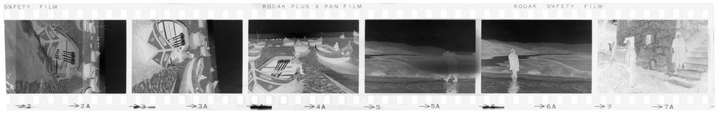 Untitled (Fishing Boats On The Coast; Men Walking On Beach; Old Man And Woman In Street, Nazaré, Portugal)