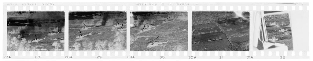 Untitled (Helicopters Flying Over Open Field And Paddies, Vietnam)