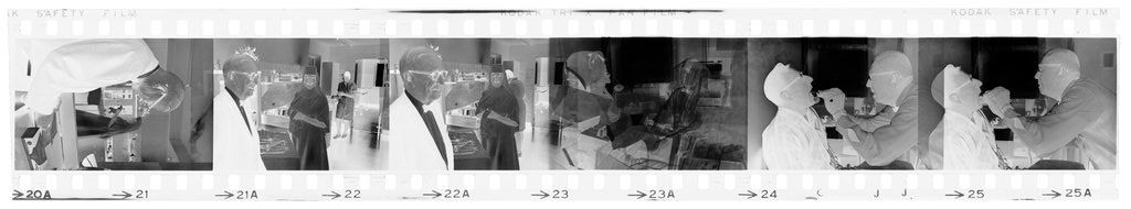 Untitled (Dr. Herman M. Juergens, In Work Area; Examining Patients)