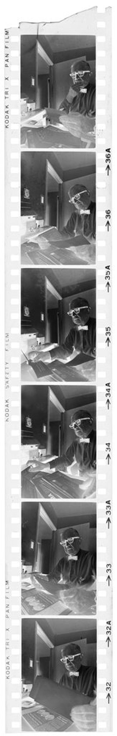 Untitled (Dr. Herman M. Juergens At Desk In Office Looking At Papers)