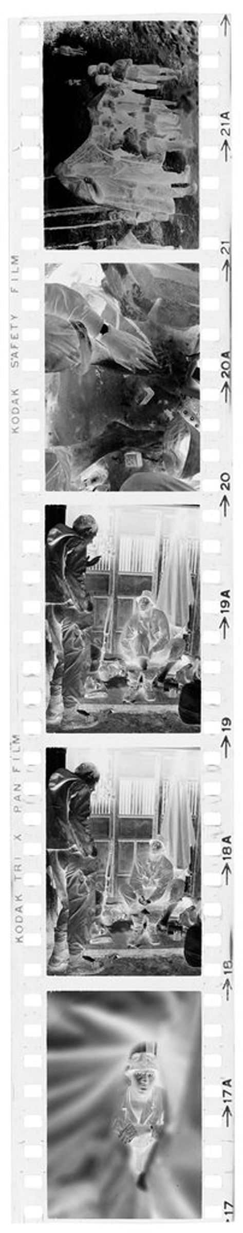 Untitled (Soldier Seated Outside Building Resting Feet; Soldier With Vietnamese Children, Vietnam)