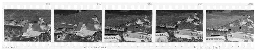 Untitled (Soldier On Top Of Army Tank With Cargo Trunks Lined Up Along Road In Background, Vietnam)