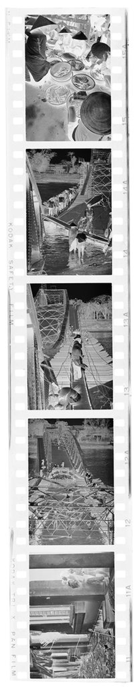 Untitled (Damaged Buildings; Bridge Crossing; Vendors, Hue, Vietnam)