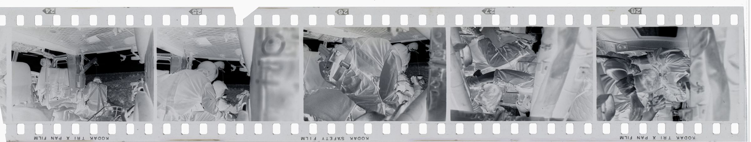 Untitled (Medevac Team Inside Helicopter Assisting Soldiers Who Have Been Hoisted Up By Pulley, Vietnam)