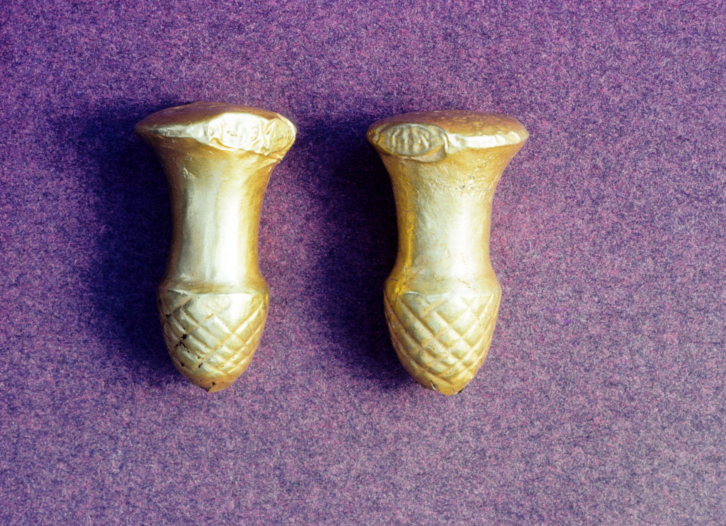 "Pair of Gold ""earplugs"""