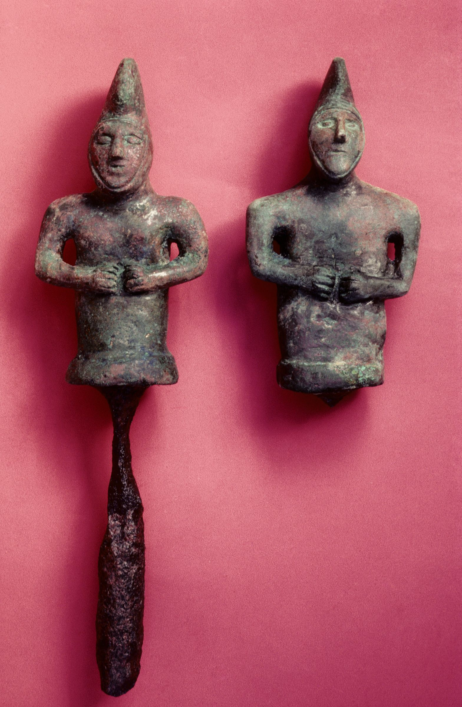 Two figural linchpins