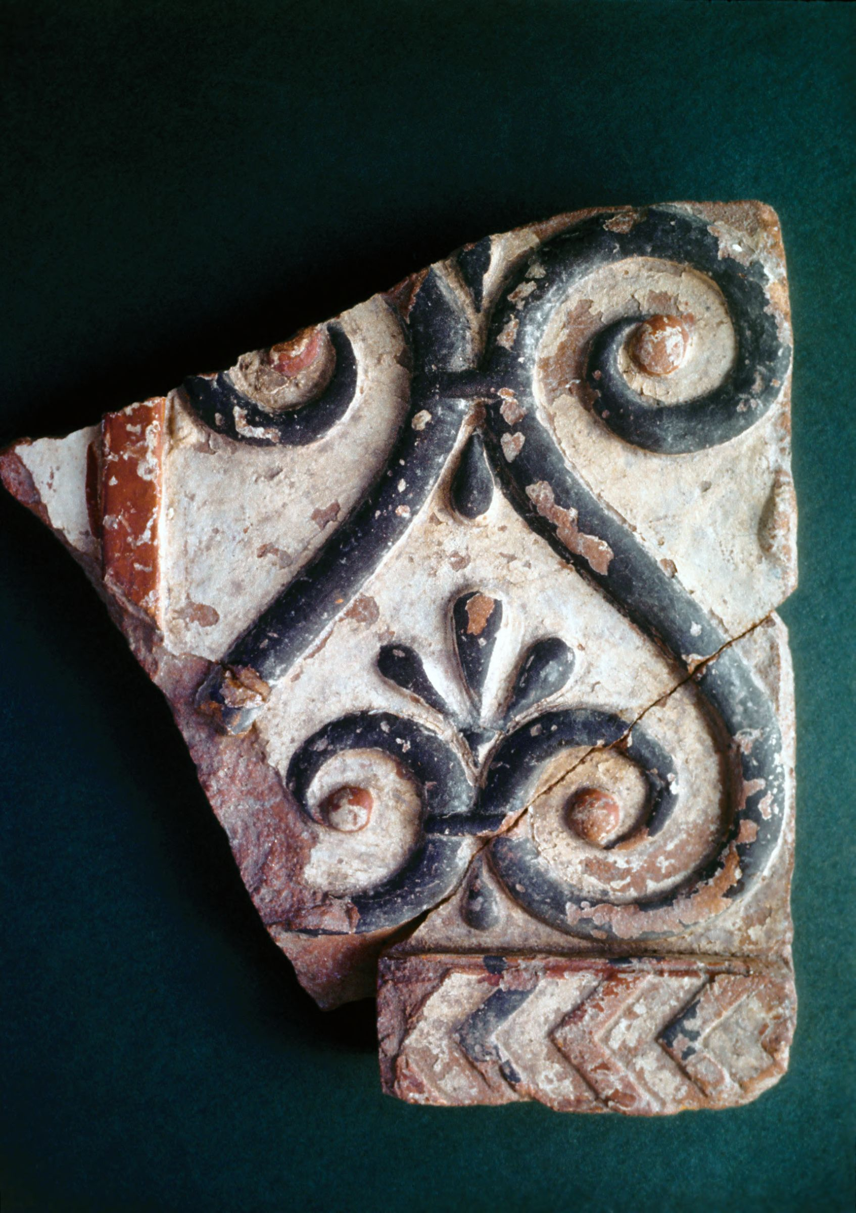 Fragment of a terracotta sima or geison, with scroll/lyre