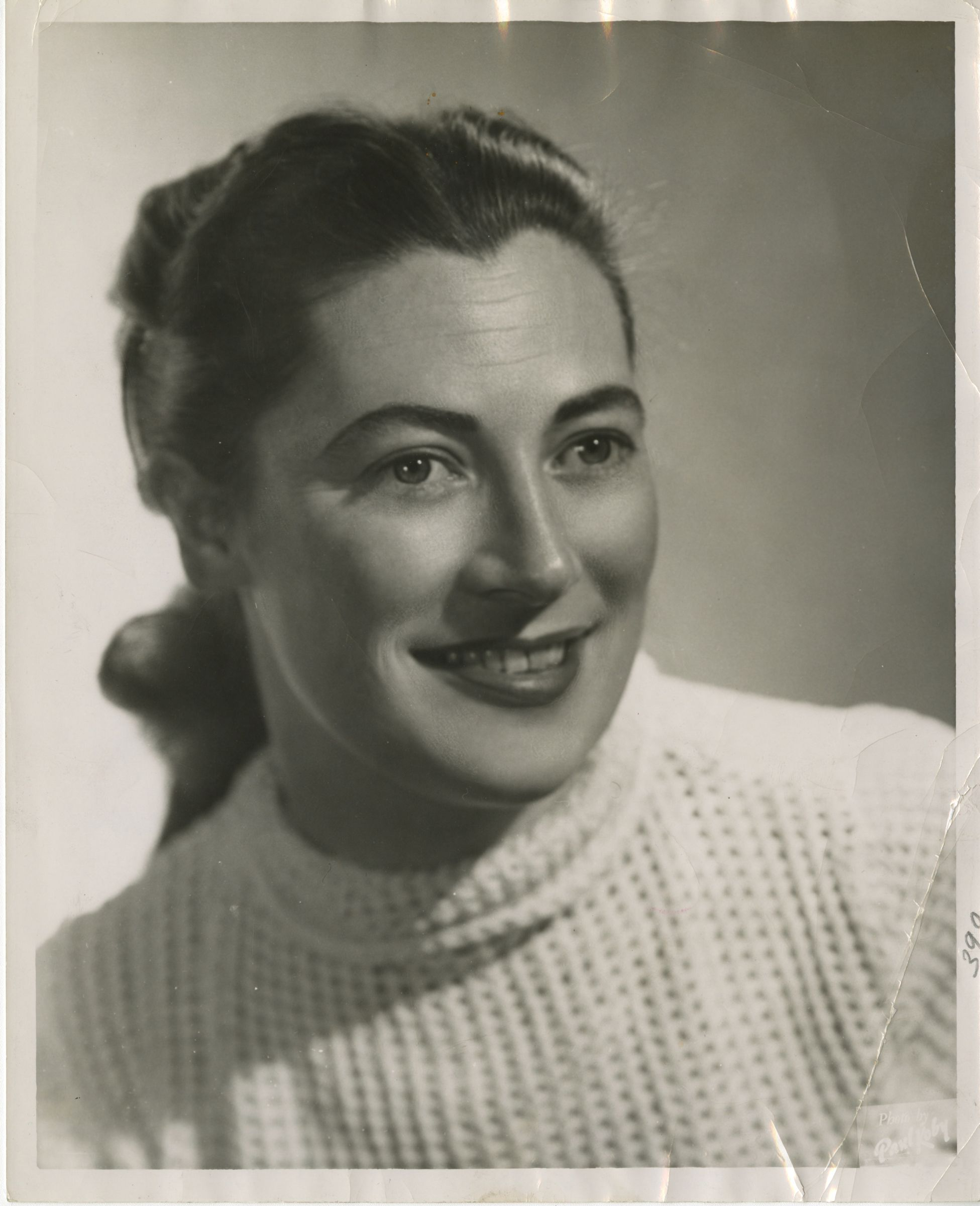 A formal portrait of Vilma R. Hunt. Black and white. She is smiling and staring off camera, wearing a white turtleneck.