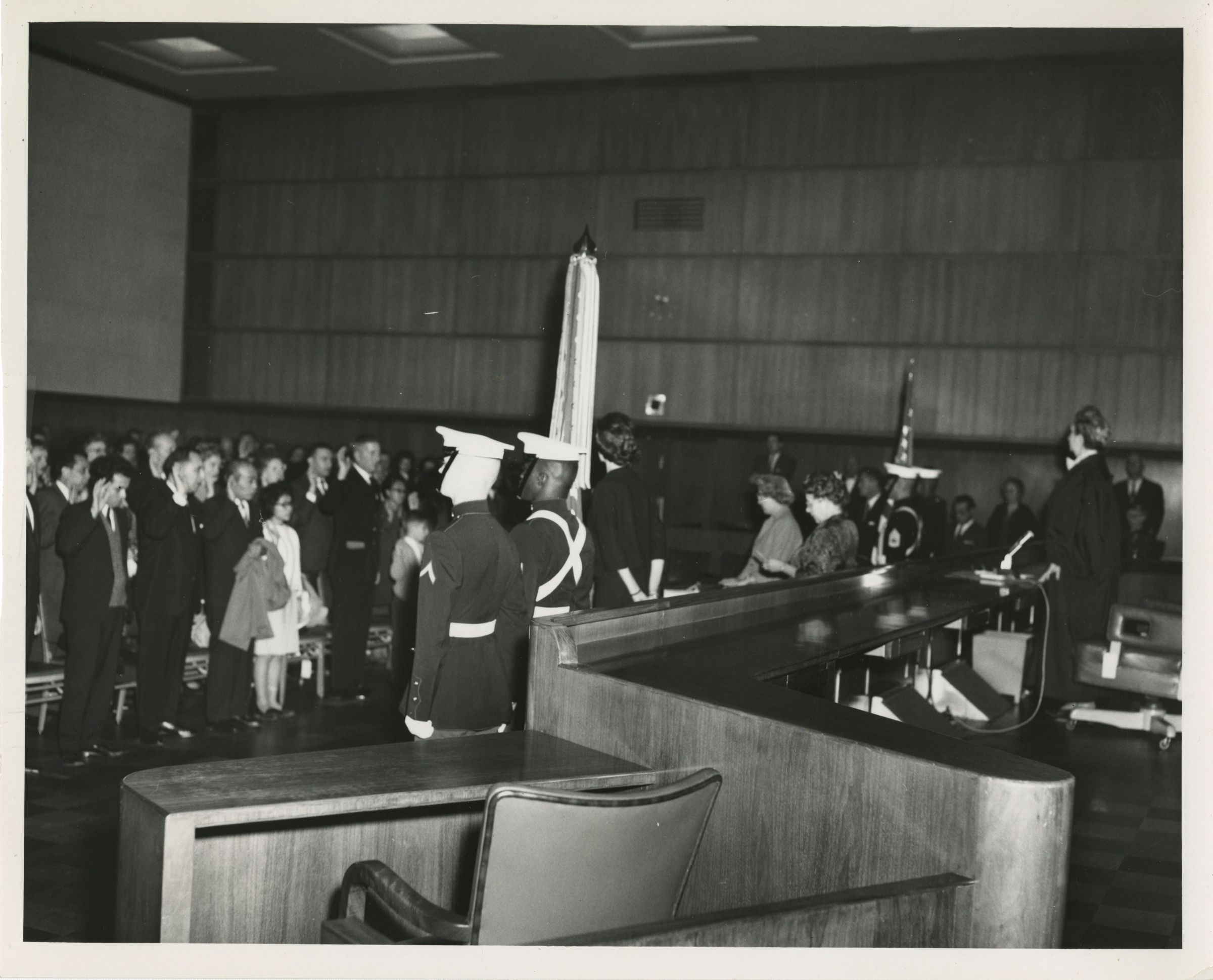 Judge Burnita Matthews presides over naturalization ceremony in a courtroom (1961)