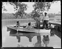 Untitled (People In Small Boat Near Dock)