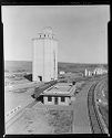 Untitled (Elevated View Of Railroad Station With Silo In Background)