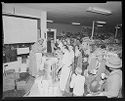 Untitled (Grocery Store Event With Woman In Costume Serving Food)