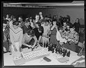 Untitled (Teenagers Standing Around Food Table At Gymnasium Event)