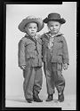 Untitled (Studio Portrait Of Two Boys In Cowboy Clothes Wearing Hats)