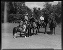 Untitled (Five People Posed On Horseback Next To Tall Grass And Trees)