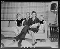 Untitled (Family With Two Girls And Baby Posed Sitting On Living Room Couch)