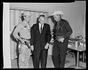 Untitled (Man In Suit Flanked By Two Men In Western Wear With Pistols)