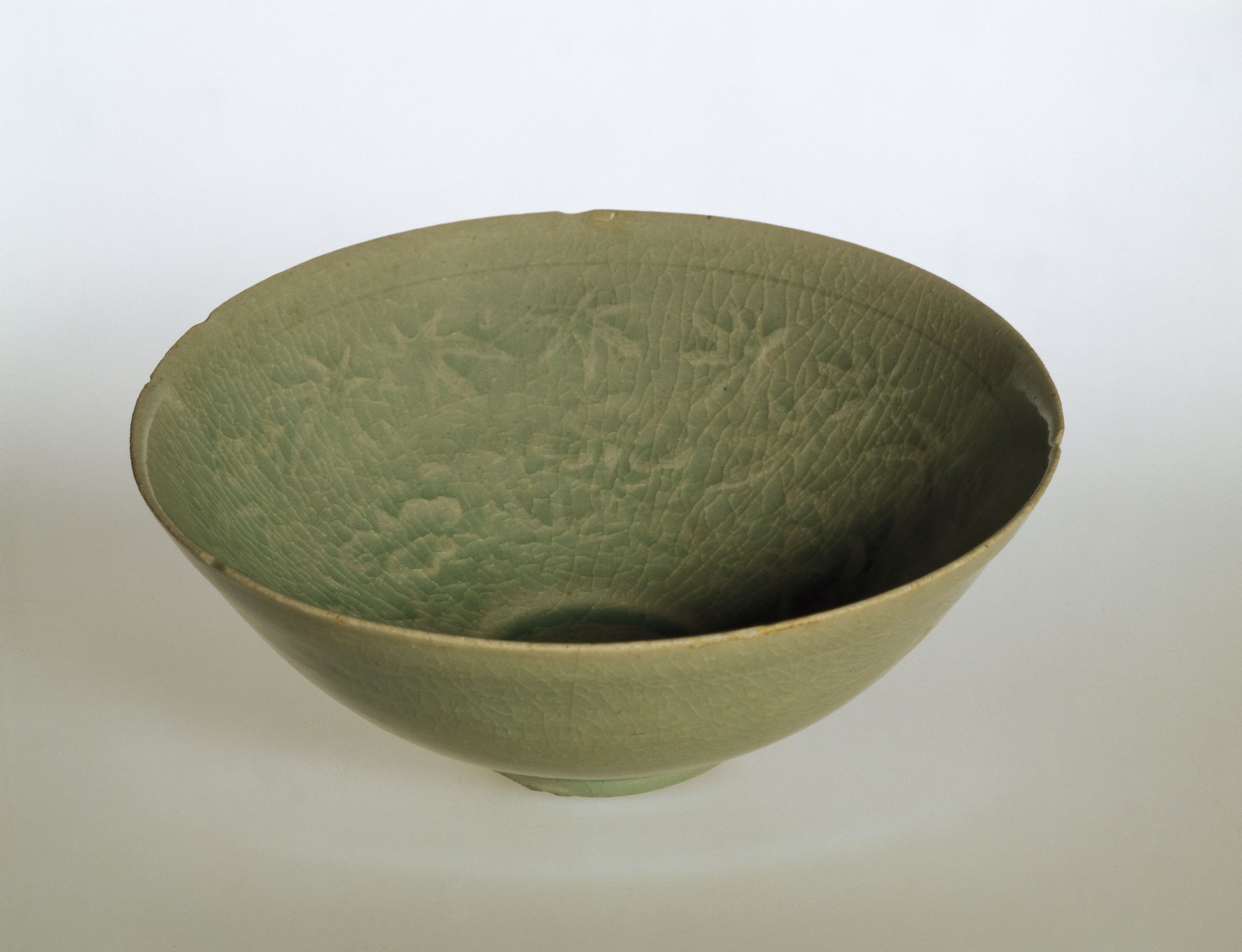 Circular Bowl With Notched Rim And Hibiscus Decor