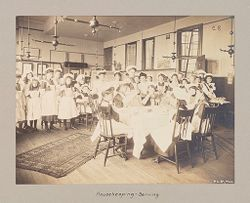 Education, Industrial: United States. New York. New York City. Public Schools, Adaptation to Special Needs: New York City Public Schools. Examples of the Adaptation of Education to Special City Needs: Public School No. 37 Manhattan: Housekeeping-Serving..   Social Museum Collection