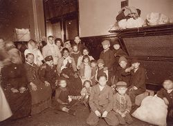Races, Immigration: United States. New York. New York City. Immigrant Station: Regulation of Immigration at the Port of Entry, United States Immigrant Station, New York City: Group of Those to Be Deported..   Social Museum Collection