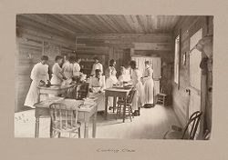 "Social Settlements: United States. Alabama. Calhoun. ""Calhoun Colored School"": Agencies Promoting Assimilation of the Negro. Training Negro Girls in Domestic Science. Calhoun Colored School, Calhoun, Ala.: Cooking Class.   Social Museum Collection"