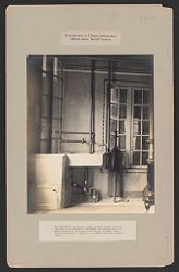 Housing, Industrial: United States. Virginia. Virginia Highlands: Experiments in Cheap Construction. Milton Dana Morrill System: The kitchen of the poured house, showing cement sink and wash-tub, with enclosure underneath for garbage pail. A small force-pump furnishes water supply at small cost.  The entire house is heated by hot-water from the kitchen range..   Social Museum Collection