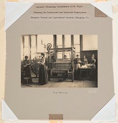Races, Negroes: United States. Virginia. Hampton. Hampton Normal and Industrial School: Agencies Promoting Assimilation of the Negro: Training for Commercial and Industrial Employment. Hampton Normal and Agricultural Institute, Hampton, Va.: Rug Weaving..   Social Museum Collection