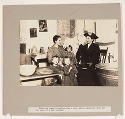 Charity, Organizations: United States: District nurse investigating a case which impressed upon her the need of a day nursery..   Social Museum Collection