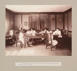 """Charity, Children: United States. New York. Pleasantville. Hebrew Sheltering Guardian Society: Hebrew Sheltering Guardian Society Orphan Asylum, Pleasantville, New York: The """"little sisters"""" dictate while the """"big sisters"""" write their letters..   Social Museum Collection"""