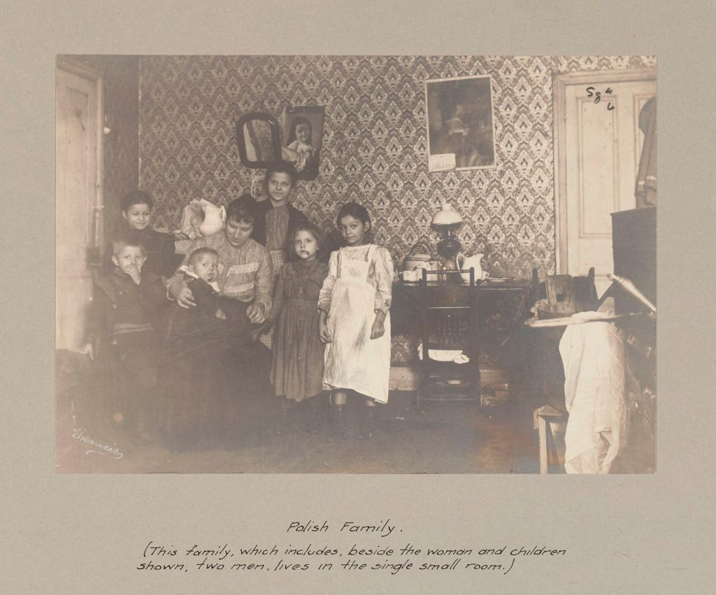 Social Settlements: United States. Pennsylvania. Philadelphia. The College Settlement: Environment After Immigration. Perpetuation Of European Standards In America. The College Settlement, Philadelphia, Pa.: Polish Family. (This Family, Which Includes, Beside The Woman And Children Shown, Two Men, Lives In The Single Small Room.)