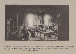 Housing, Conditions: United States. Wisconsin. Milwaukee. Tenements: Housing Conditions: Milwaukee: Family living room in the building..   Social Museum Collection