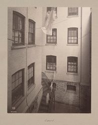 Housing, Improved: United States. New York. New York City. The Misses Stone, New Law Tenement, 1905 (W. Emerson, Architect): Improved Housing: New York City: Improved tenements of 34 East 50th Street. Erected for the Misses Stone. W. Emerson Arch't 1905. Photo 1907.: Court..   Social Museum Collection