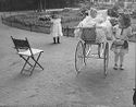 [Two Little Girls And Baby In Carriage In Park, Paris]