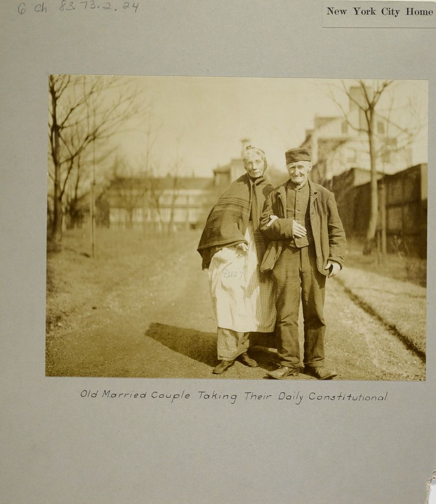 Charity, Aged: United States. New York. New York City. Home For Aged And Infirm, Manhattan Division, Blackwell's Island: New York City Home For The Aged And Infirm: Old Married Couple Taking Their Daily Constitutional.