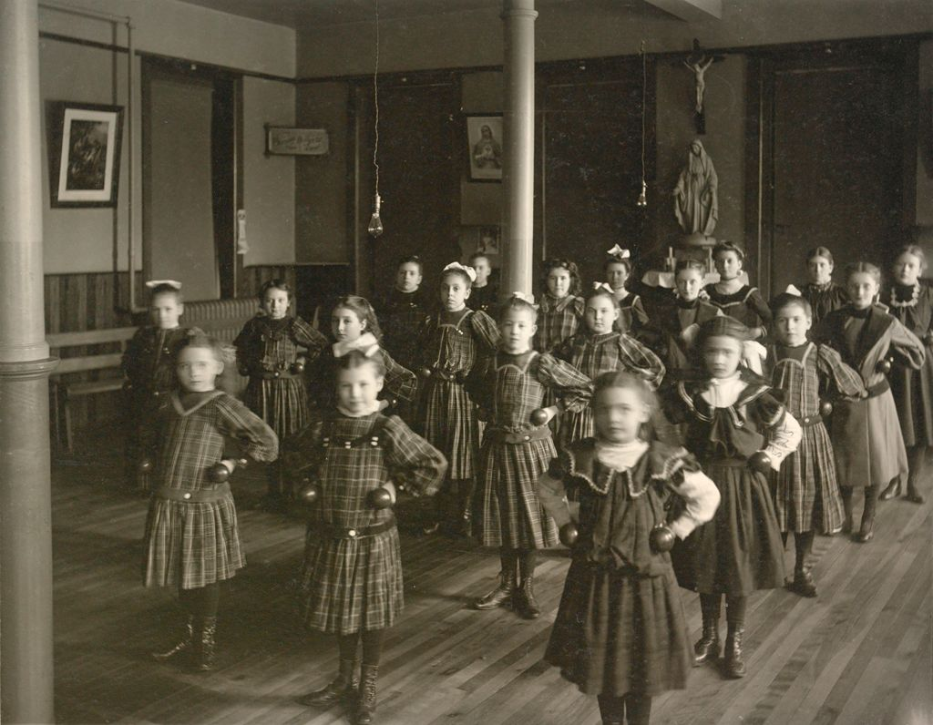 Charity, Hospitals: United States. New York. Ogdensburg. City Hospital And Orphanage: Grey Nuns Of The Cross: City Hospital And Orphanage, Ogdensburg, N.y. (Under The Direction Of The Grey Nuns Of The Cross): Little Girls At Dumbell-Exercise.