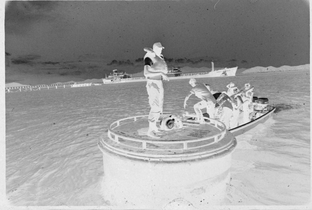Untitled (Men Stepping From Top Of Submarine(?) To Motorboat, Vietnam?)