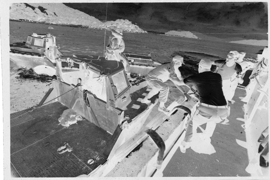 Untitled (Soldier Helped From Deck Of Small Boat Onto Deck Of Ship, Vietnam?)