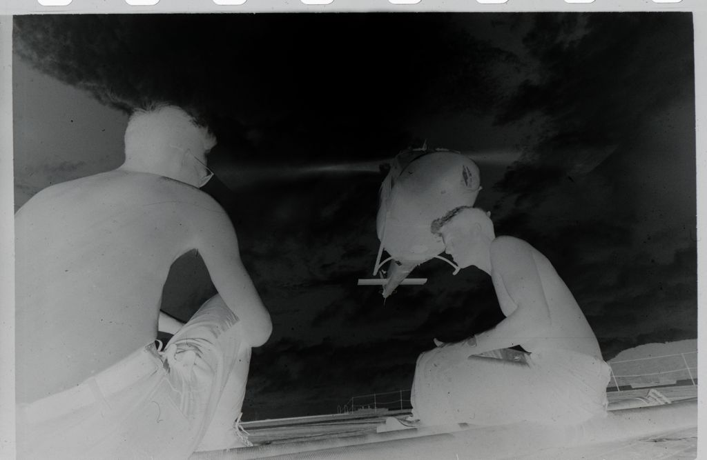 Untitled (Two Soldiers Sitting On Deck Of Ship As Helicopter Takes Off, Vietnam)